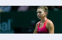 Final de sezon: Simona pierde în două seturi cu Radwanska, iese din grupe la WTA Finals